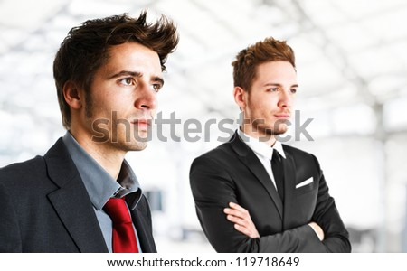 Portrait of two handsome businessmen - stock photo