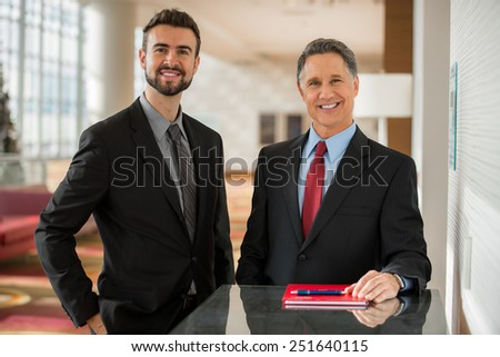 Portrait of two handsome businessmen CEO and executive confident grin at a business convention office - stock photo