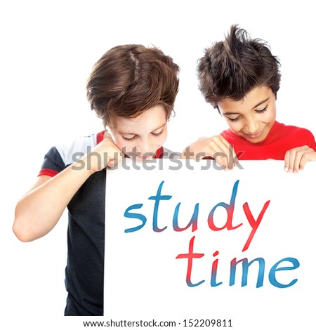"""Portrait of two happy boys holding white chalkboard with written phrase """" study time"""", isolated on white background, education concept - stock photo"""