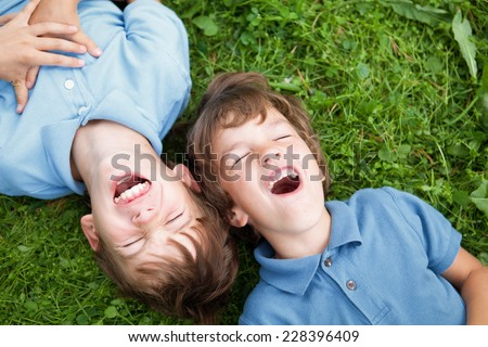 Portrait of two happy brothers in summer park - stock photo