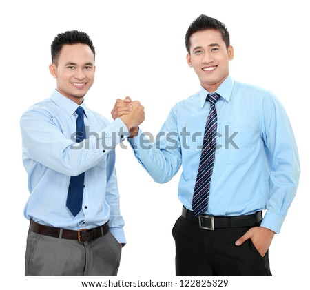 Portrait of two happy business men shaking hands isolated over white background - stock photo