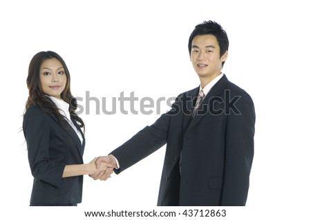 Portrait of two happy business people shaking hand