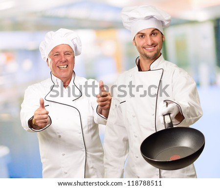 Portrait Of Two Happy Chef, Indoor - stock photo