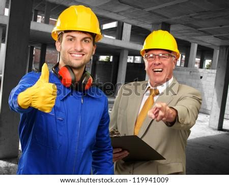 Portrait Of Two Happy Engineers, Indoor - stock photo