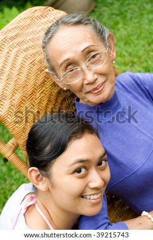 Portrait of two happy generation asian women - stock photo