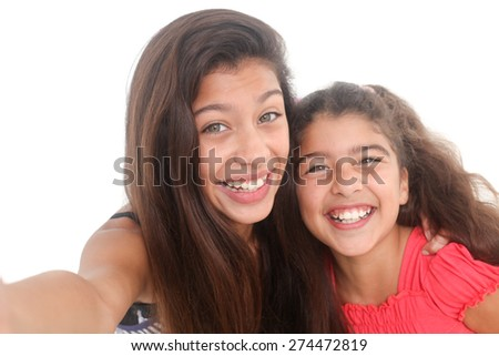 portrait of two happy girls on a white background - stock photo