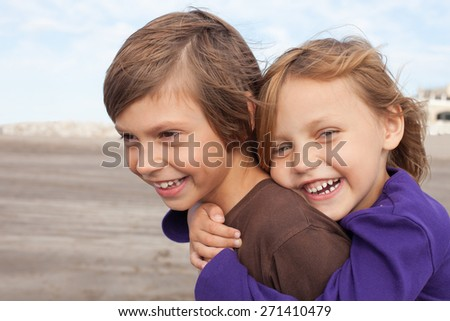 portrait of two happy kids outdoors - stock photo