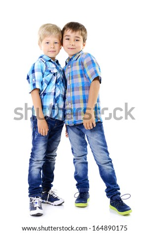 Portrait of two happy little boys friends in blue checked shirts playing together isolated on a white background - stock photo