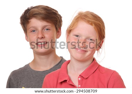Portrait of two happy teenagers on white background