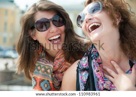 Portrait of two happy young beautiful women - stock photo