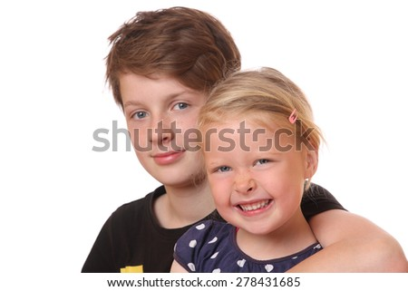 Portrait of two happy young children on white background - stock photo