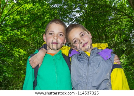 Portrait of two hugging boys, twins - stock photo
