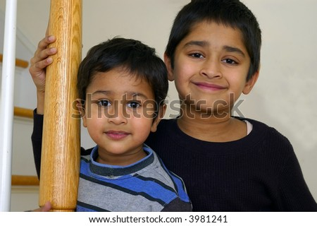 Portrait of two indian brothers on a light back ground - stock photo