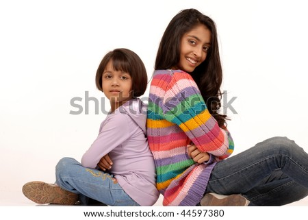 portrait of two indian sisters - stock photo