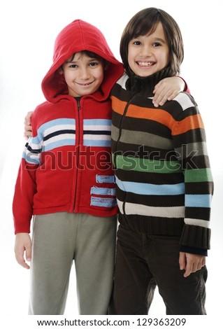 Portrait of two joyful kids isolated on white background - stock photo