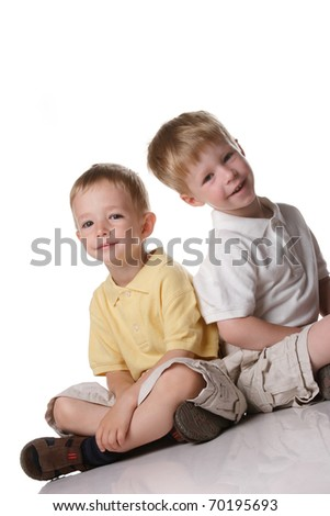 portrait of two little boys in the studio - stock photo