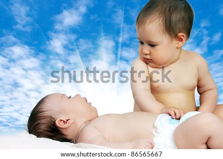 portrait of two little cute babies in the sky - stock photo