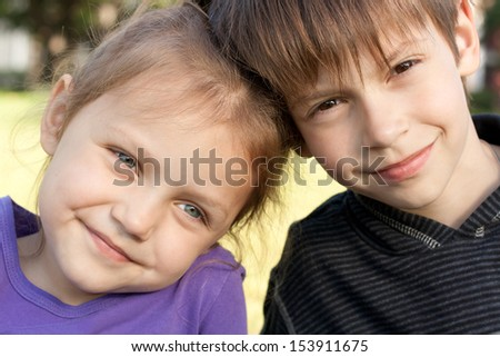 portrait of two little friends outdoors