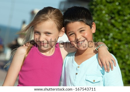 portrait of two little friends outdoors - stock photo