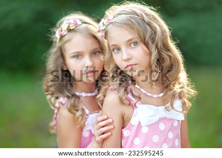 Portrait of two little girls twins - stock photo