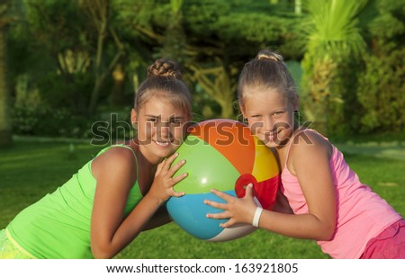 Portrait of two little girls with beach ball