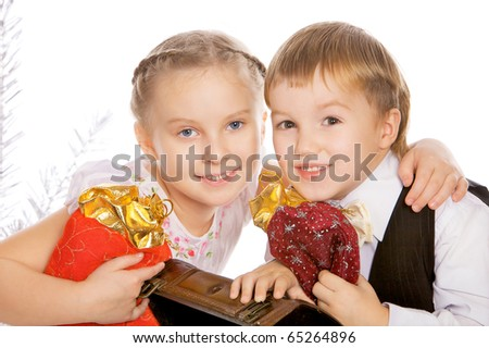 Portrait of two lovely children with Christmas box