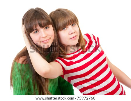 Portrait of two lovely sisters isolated on white background - stock photo