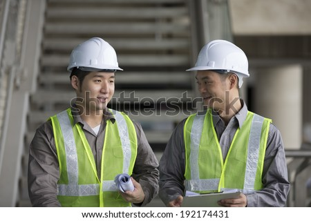 Portrait of two male Chinese industrial engineer's at work