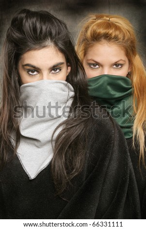 Portrait of two masked models. - stock photo