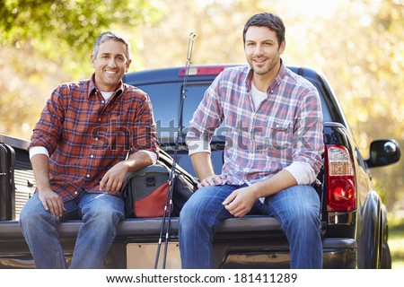 Portrait Of Two Men In Pick Up Truck On Camping Holiday - stock photo