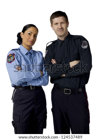 Portrait of two mid adult police officers standing on a white background - stock photo