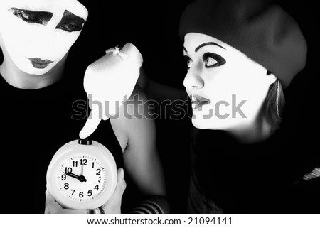 Portrait of two mimes on a black background