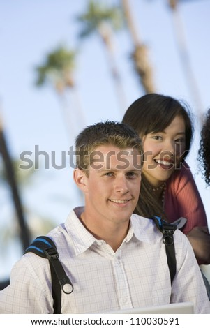 Portrait of two multiethnic college students smiling