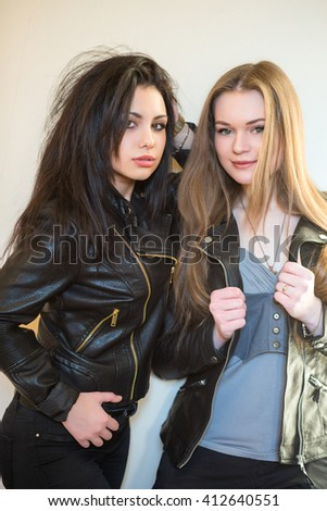 Portrait of two nice women posing in casual clothes - stock photo