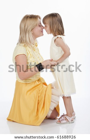 Portrait of two persons, loving mother and daughter, touching their nose, studio image - stock photo