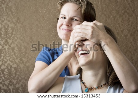 Portrait of Two Pretty Young Women Friends Playing and Laughing - stock photo