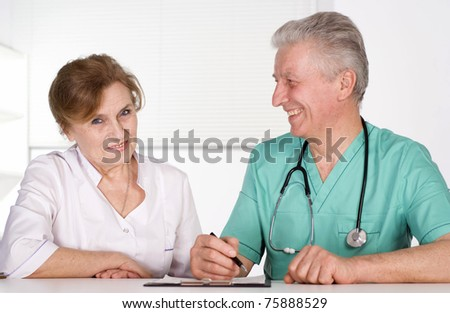 portrait of two senior doctors on white