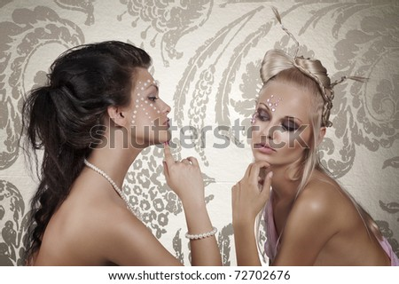portrait of two sensual beauty girl with creative make up and hair style posing - stock photo