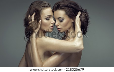 Portrait of two sexy woman hugging each other - stock photo