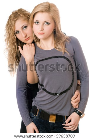 Portrait of two sexy young women. Isolated - stock photo