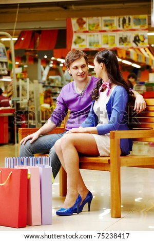 Portrait of two shopaholics chatting after shopping - stock photo