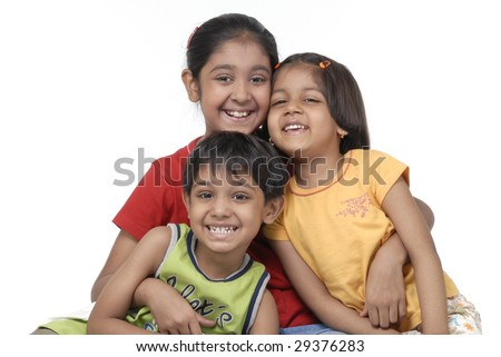 portrait of two sisters and one brother - stock photo