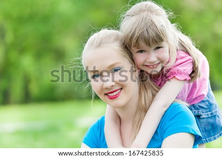 Portrait of two sisters in the park
