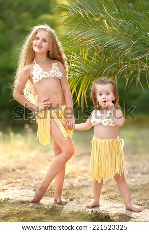 portrait of two sisters in tropical style - stock photo