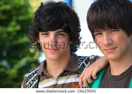 Portrait of two smiling boys - stock photo