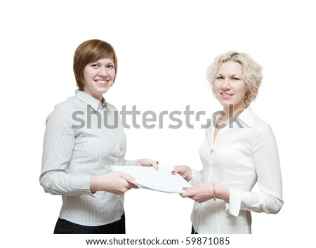 Portrait of two smiling business woman holding document  over white - stock photo