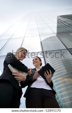 Portrait of two smiling businesswomen - stock photo