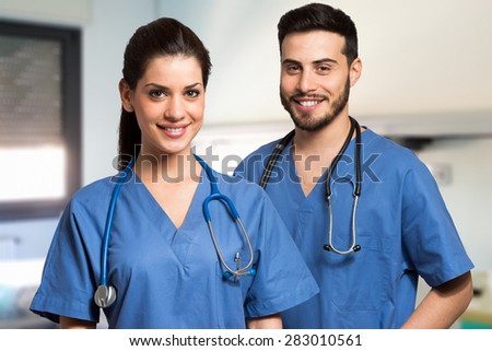 Portrait of two smiling medical workers - stock photo