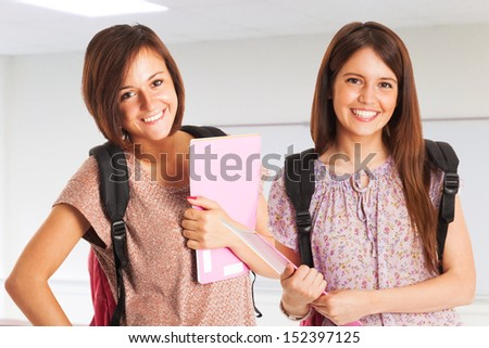 Portrait of two students in a classroom - stock photo