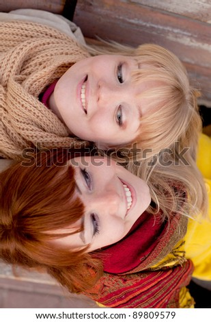 portrait of two teenage girls outdoors - stock photo